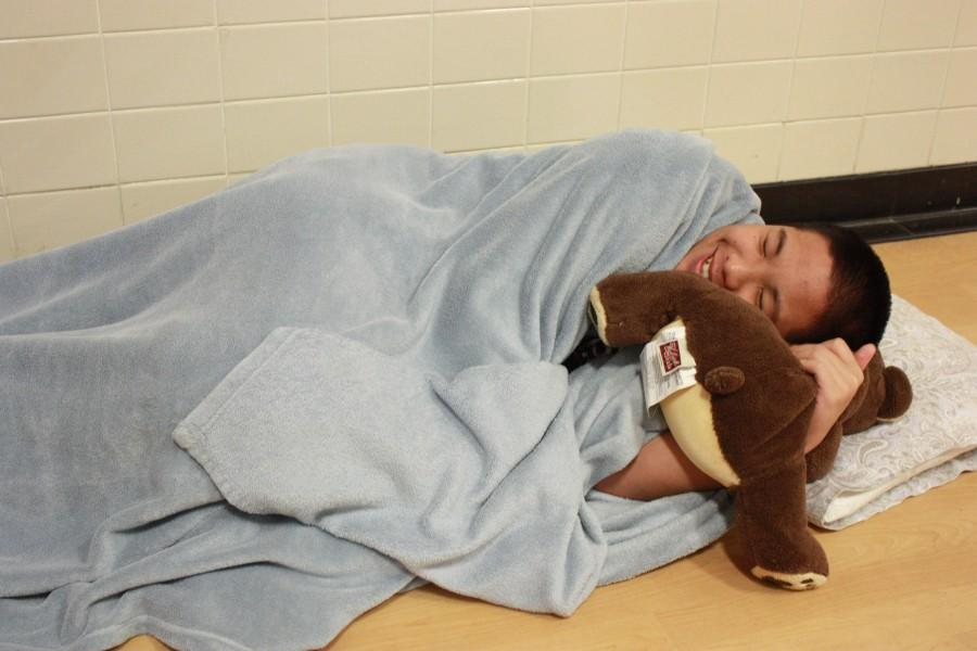 Sophomore Sean Tran brings a blanket, pillow and stuffed animal to school for Pajama Day on April 27.