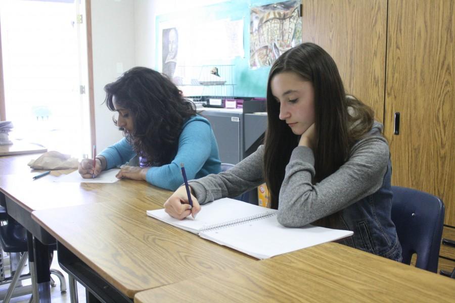 Sophomore Anusha Balani and freshman Anna Lulushi stress-write alongside other students during A Block on May 1.