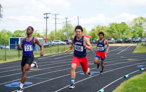 After receiving the baton from sophomore Jacob Adolphe, Junior Jesse Cai goes all-out during the boys' 4x100 relay.