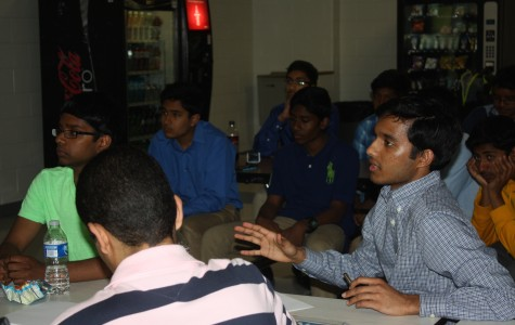 Senior Ani Chandrabhatla gives feedback on a team's product.