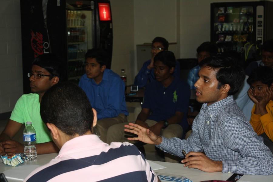 Senior+Ani+Chandrabhatla+gives+feedback+on+a+team%27s+product.