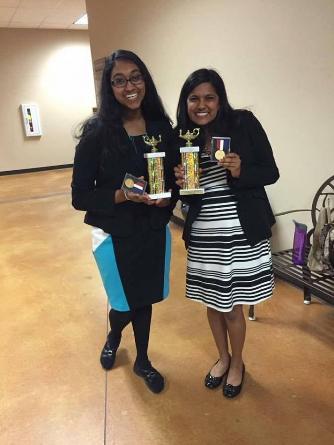 Juniors Kiran Girish and Sahana Ramani show off the awards they have won for debate.