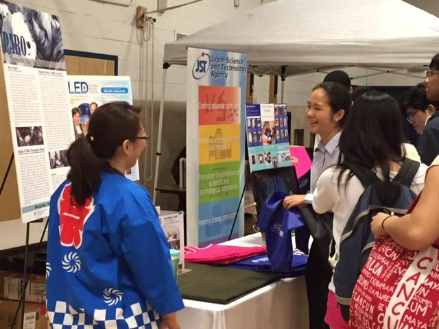 Senior Bridget Park talks to one of the representatives of AIST, a Japanese research facility that developed Paro, a therapeutic robot.