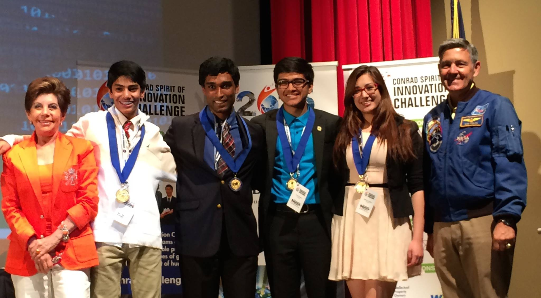 From left to right: founder and chairman Nancy Conrad, sophomore Rohan Suri, junior Kevin Livingstone, sophomore Varun Iyengar, junior Claire Scoggins and former NASA astronaunt Robert Cabana celebrate the team behind Suri Labs being recognized as Pete Conrad scholars.