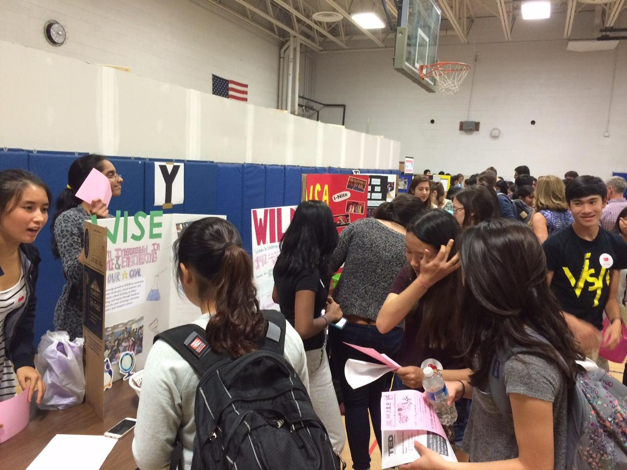 Representatives at club booths in Gym 2 talk with new students about the many activities Jefferson has to offer.