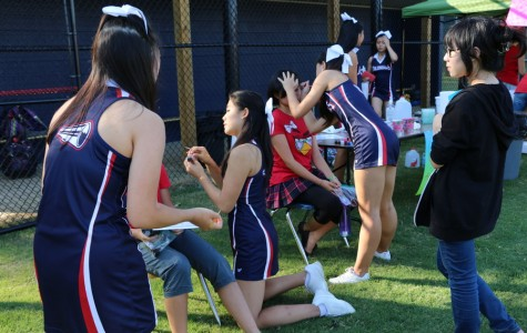 The cheerleading squad face paints students during the Back-to-School Bash