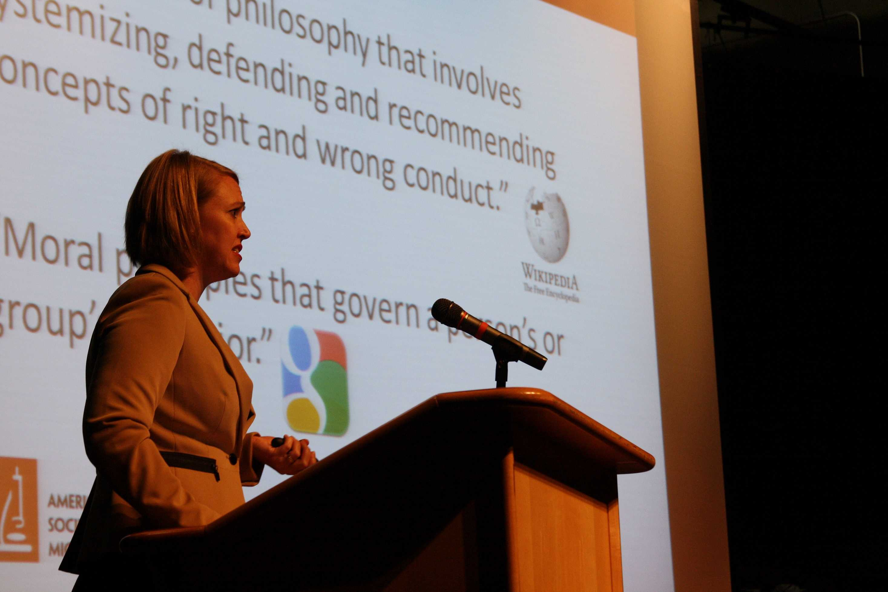 Keynote speaker Dr. Davies speaks in the auditorium about research that violated ethical and moral standards.