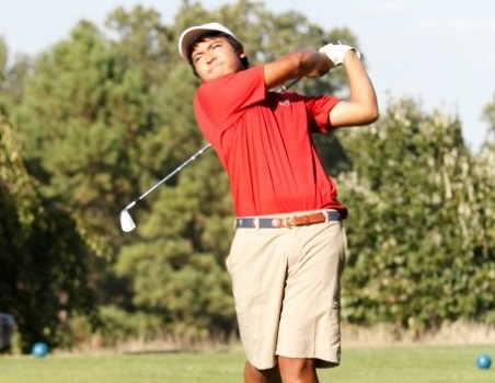 Senior Nathan Chuwait takes a shot in the competition against Thomas Edison HS at the Pinecrest golf course on Sept 17