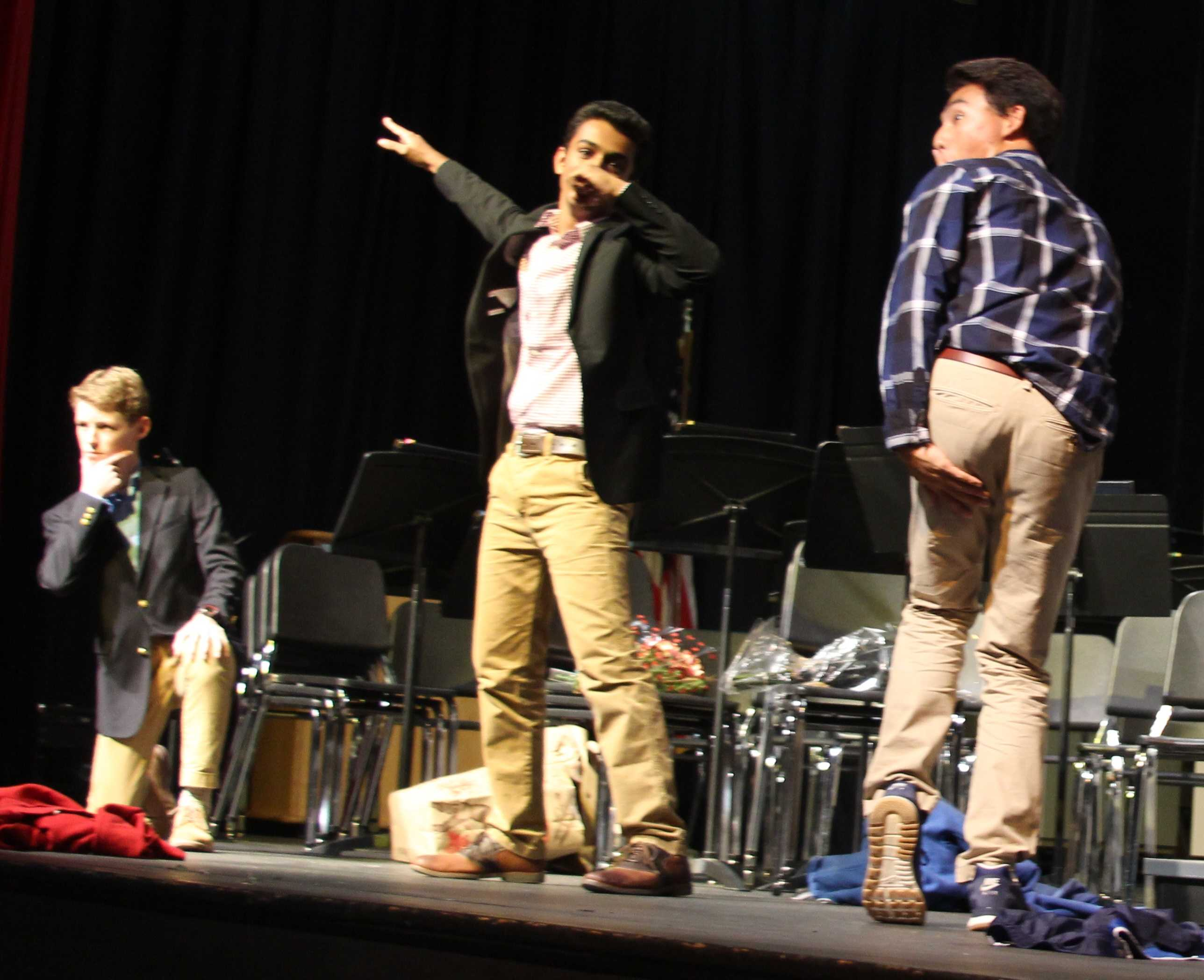 Juniors CJ Wilson, Sishaar Rao, Nick Yoon, and Jack Schefer (not pictured) ask four girls to homecoming in the auditorium during break Wednesday afternoon.