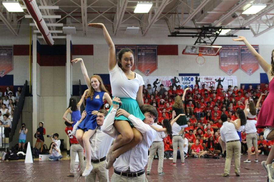 Seniors Vivian Fang and Jasper Treakle dance as a couple.