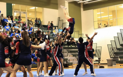The Jefferson cheer team performs a handstand vault over to pyramid during their routine at the Capitol Conference on Oct. 26