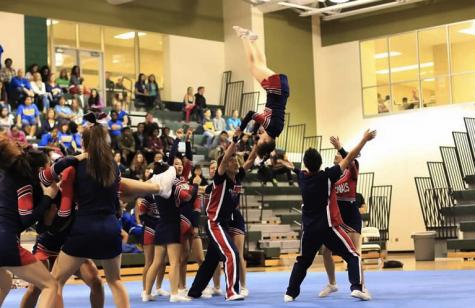 Varsity cheer trains for district semifinals
