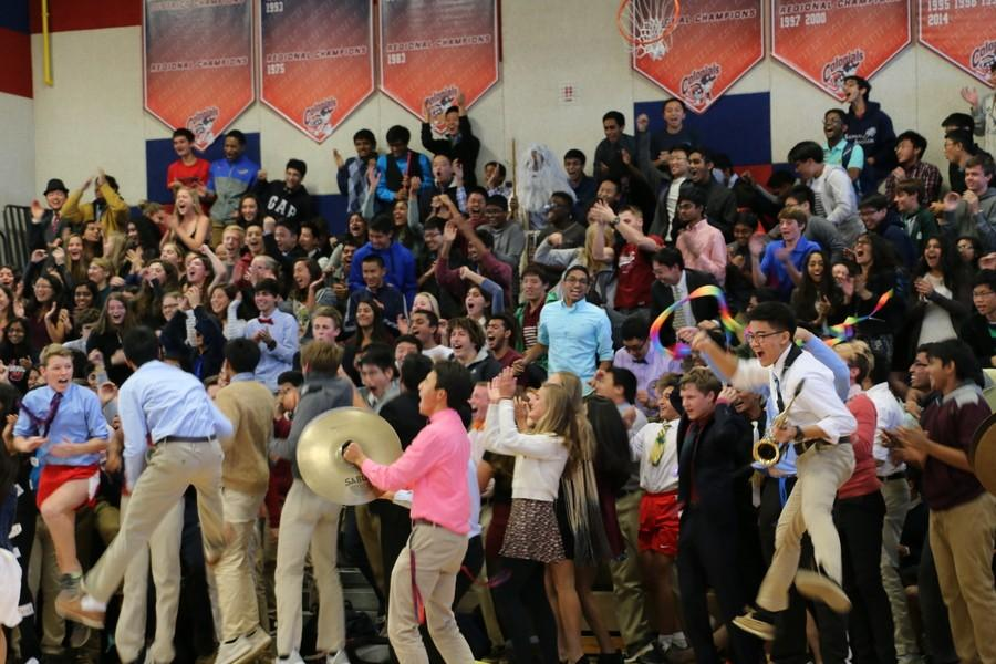 The junior class yells their class cheer during roll call