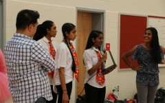 Sophomores Jahnavi Prabhala, Sahana Aiyer, Shivani Mullapudi and Shreya Chappidi and class sponsor Charles delaCuesta lead the Class of 2018s MEX rehearsal.