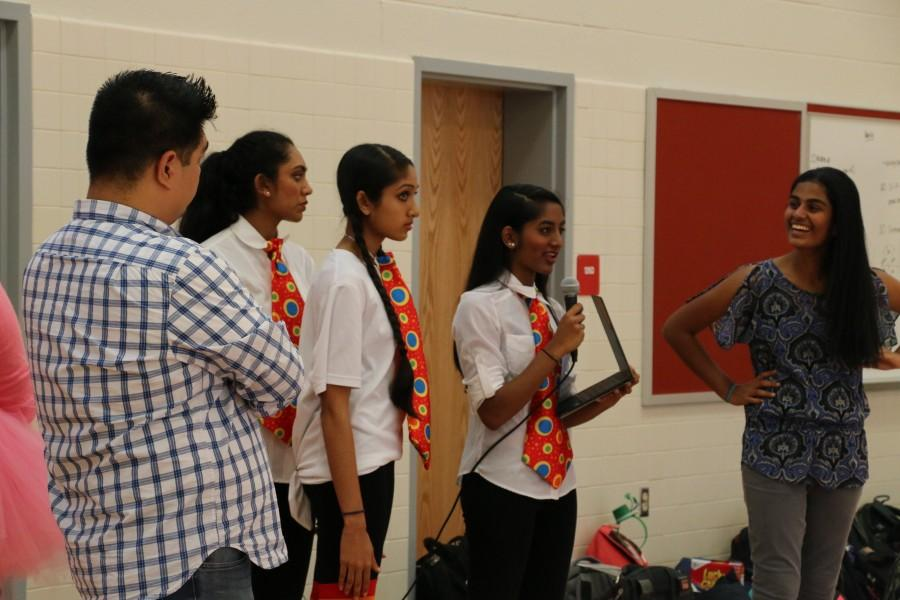 Sophomores Jahnavi Prabhala, Sahana Aiyer, Shivani Mullapudi and Shreya Chappidi and class sponsor Charles delaCuesta lead the Class of 2018's MEX rehearsal.