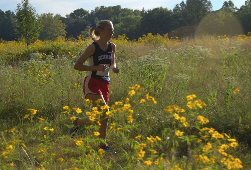 Sophomore Margaret Covey runs long distance during a cross country meet.