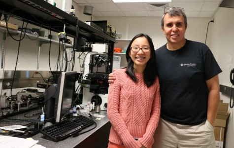 Eric Betzig shows Team Leader Katherine Du the initial models of his PALM microscope.