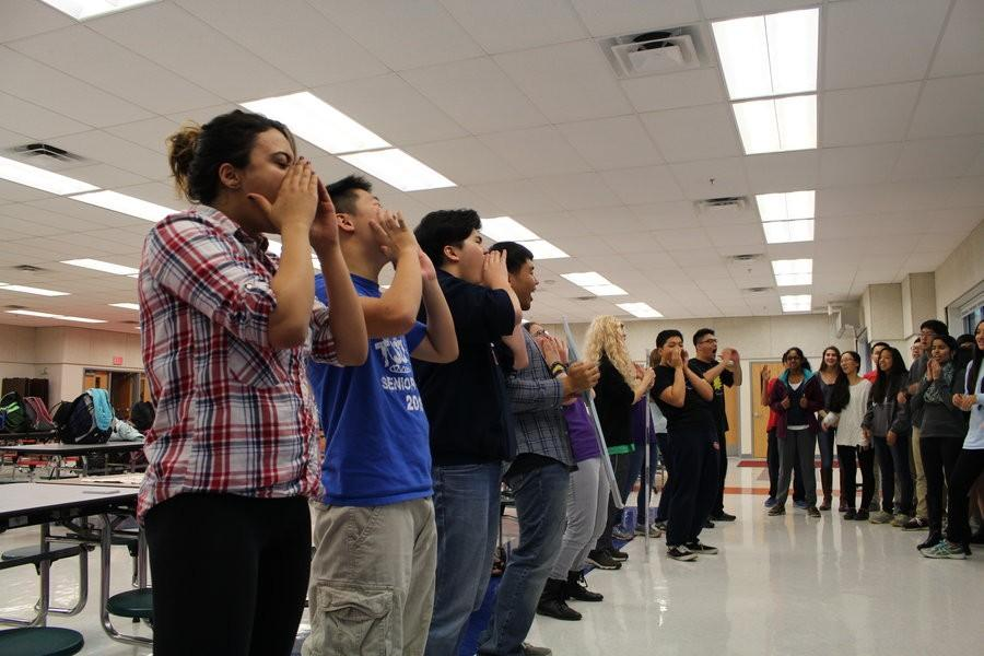 Latin club members demonstrate spirit cheers for the VJCL convention
