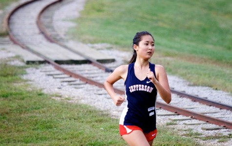 Cross country runner Sarah Kim runs in a race for the last time in her Jefferson career.
