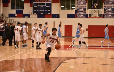 Varsity Boys Basketball Plays Winning Game on New Gym Floor