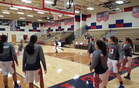 The Jefferson varsity girls' basketball team prepares to play against Madeira
