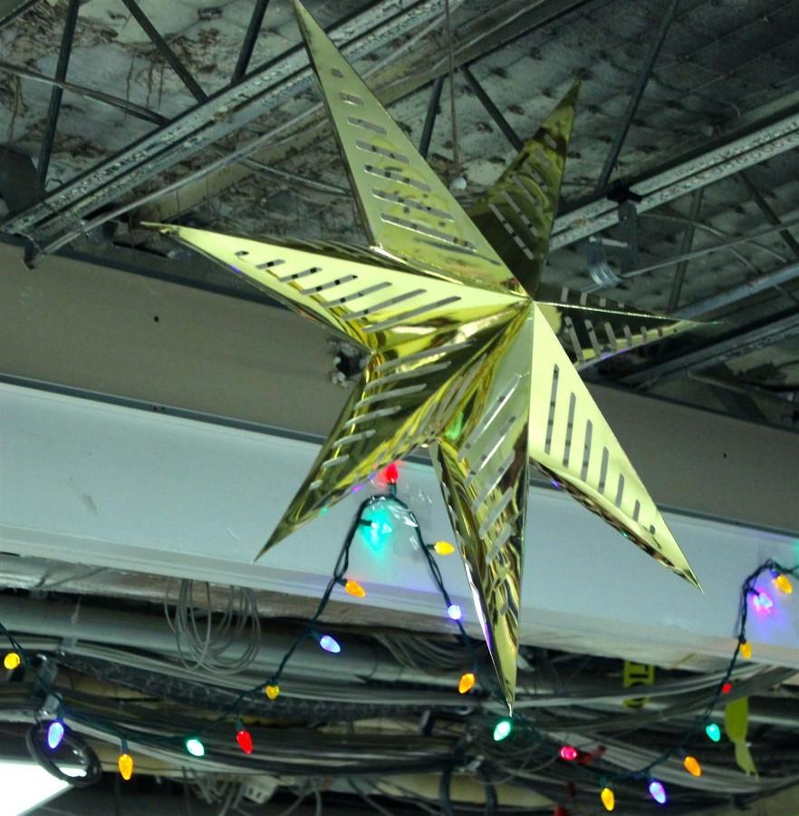 Vibrant+lights+and+a+golden+star+hang+from+the+rafters+on+Thursday%2C+December+10th.+