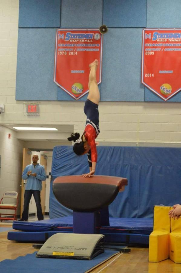 Sophomore Lilly Ko does a vault at TJ Gymnastics' most recent meet at Falls Church High School in Falls Church, VA on Dec. 7, 2015.