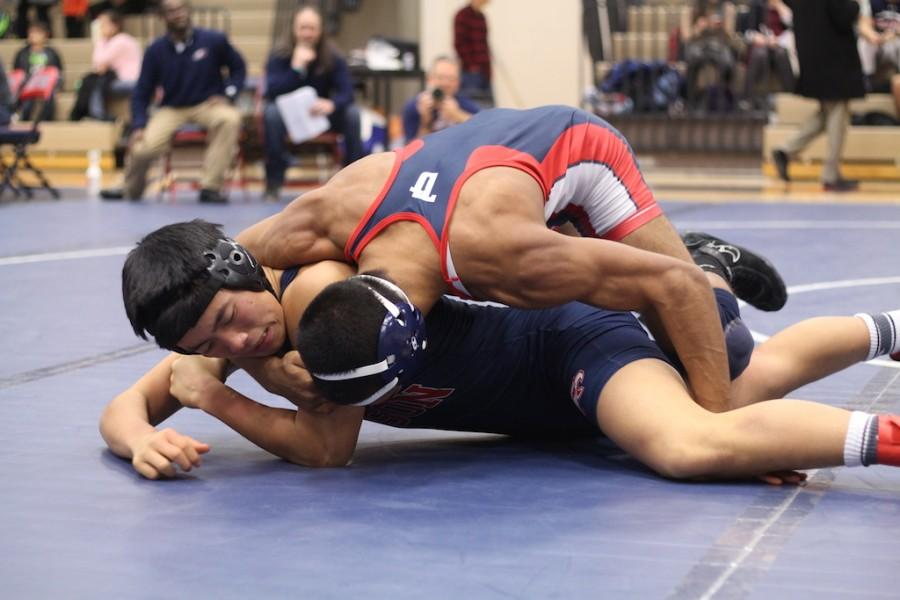 Celebrating his senior night match, Vikram Gupta successfully pins Edison.