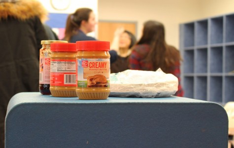 Participants at the Jefferson UNICEF club's sandwich making event on Feb. 19 placed left over peanut butter and jelly together while cleaning up the Einstein Commons. The sandwiches made at the event will be donated to a shelter.