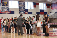 Dr. Glazer shakes hands with the senior dance team members.