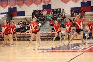The dance team begins their half time performance.