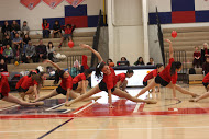 The dance team shows their flexibility with this dance move during the half time performance.