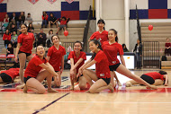 The dance team ends their show with this pose as they smile from ear to ear.