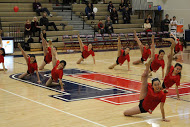 Jefferson dance team performs their routine at the boys basketball and their senior night.