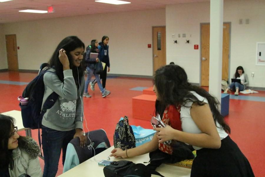Active Mindss Random Acts of Kindness on Feb. 25 involved students giving out Hershey kisses throughout the school. Sophomore Nira Harikrishnan is working with Active Minds to help spread joy and pass out these chocolate kisses to students like sophomore Nikita Sivakumar.