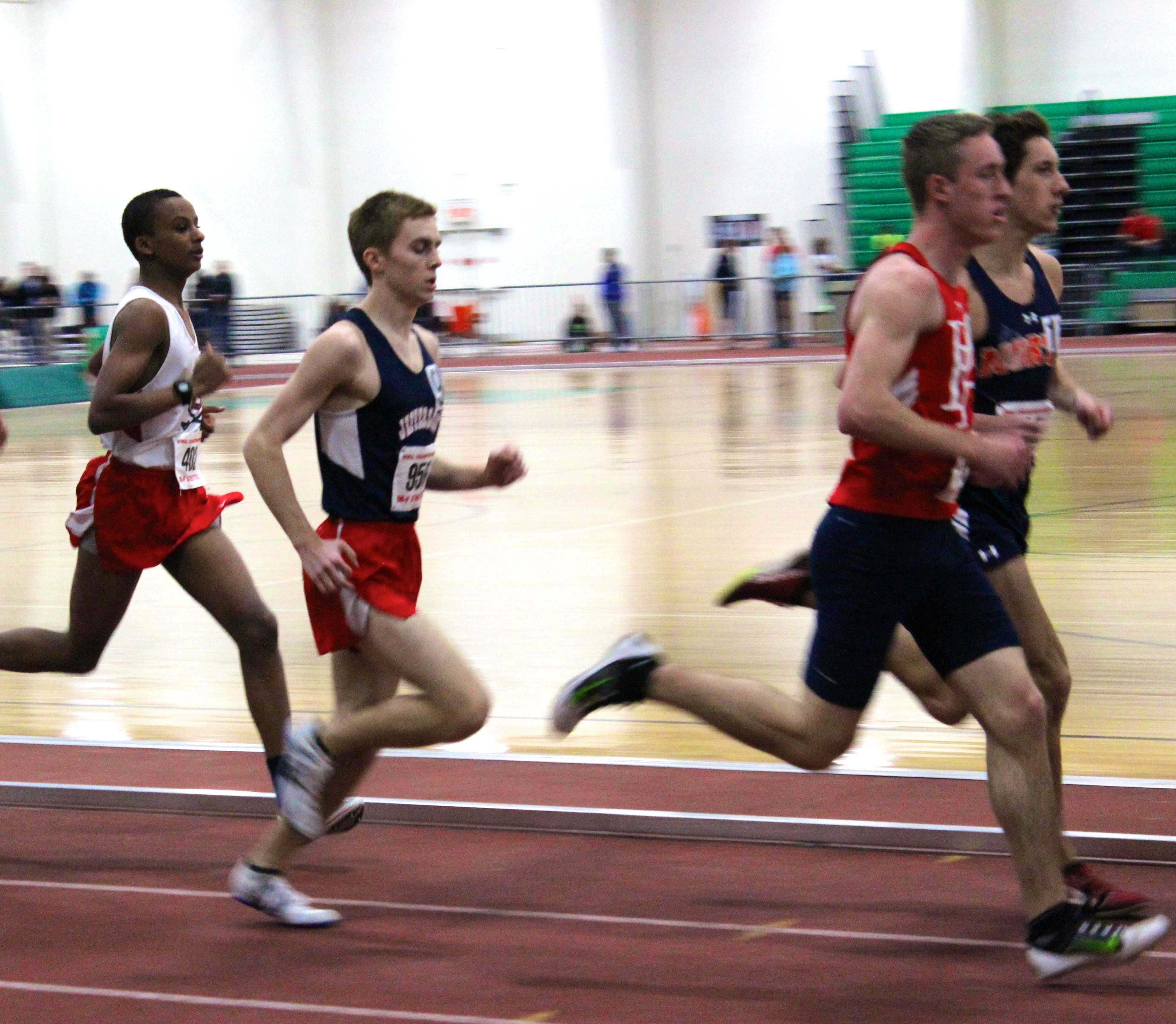 Senior distance runner Nate Foss hung back in the early laps, then overcame his competitors to win third overall in the 1600 meter race.