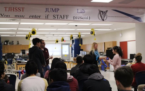 Jefferson students congratulate Katherine Barbano and Eugene Jeong as they are called up to receive recognition and a ribbon for placing first in the Energy: Chemistry category of science fair. The awards ceremony took place in the Da Vinci Commons on February 9th during JLC.