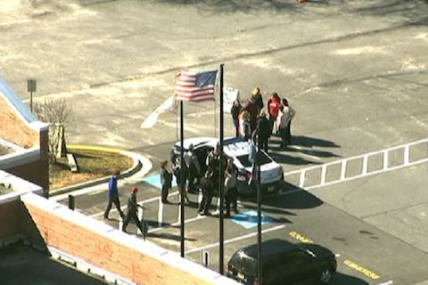 Police officers and school officials convene at McLean High School following a bomb threat on Feb. 29. According to police, this threat is not connected to the threats made later that week, on March 4.