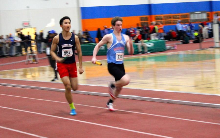 Sprinter Charlie Guan runs  his third and final event, the boys' 4x200m relay.