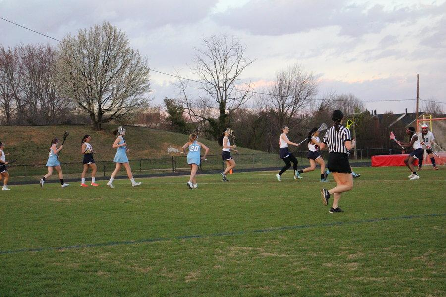 Freshman Manna Haile, defense, stands in front of Jefferson's goal against a Marshall player during the girls JV lacrosse game on March 17.