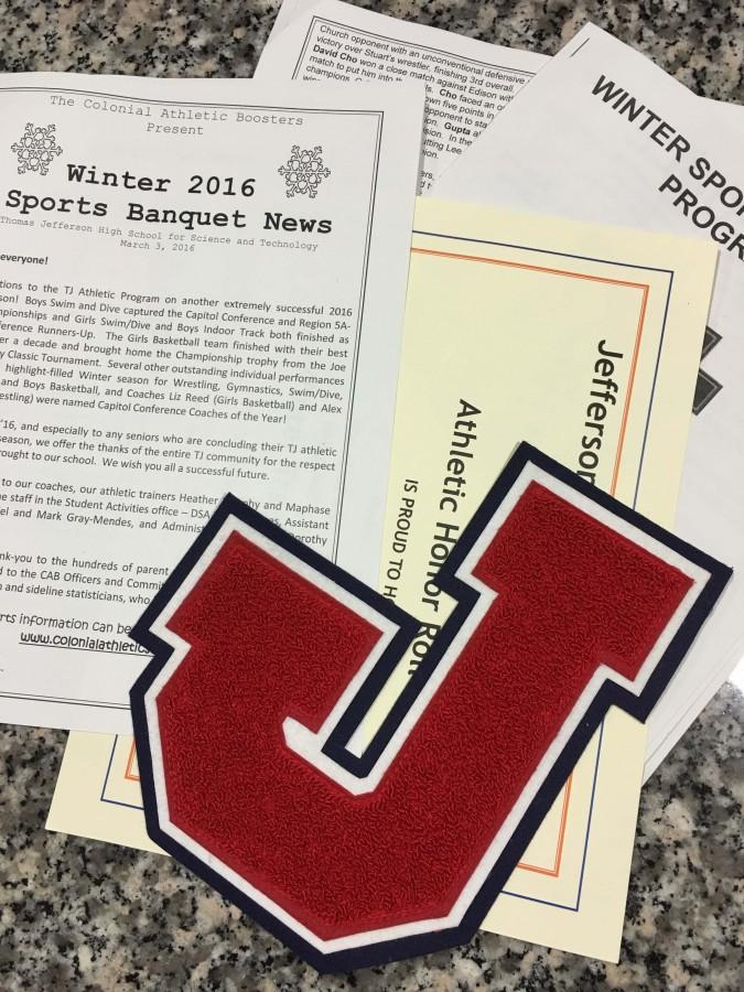 A varsity letter along with one of the certificates and programs students might have picked up at the Winter Sports Award Ceremony.