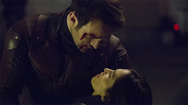 Matt Murdock (Charlie Cox) holds an injured Elektra (Elodie Yung).
