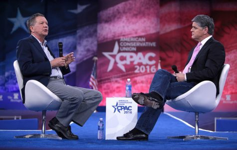 Presidential candidate John Kasich speaks to political commentator Sean Hannity at the 2016 Conservative Political Action Conference (CPAC).
