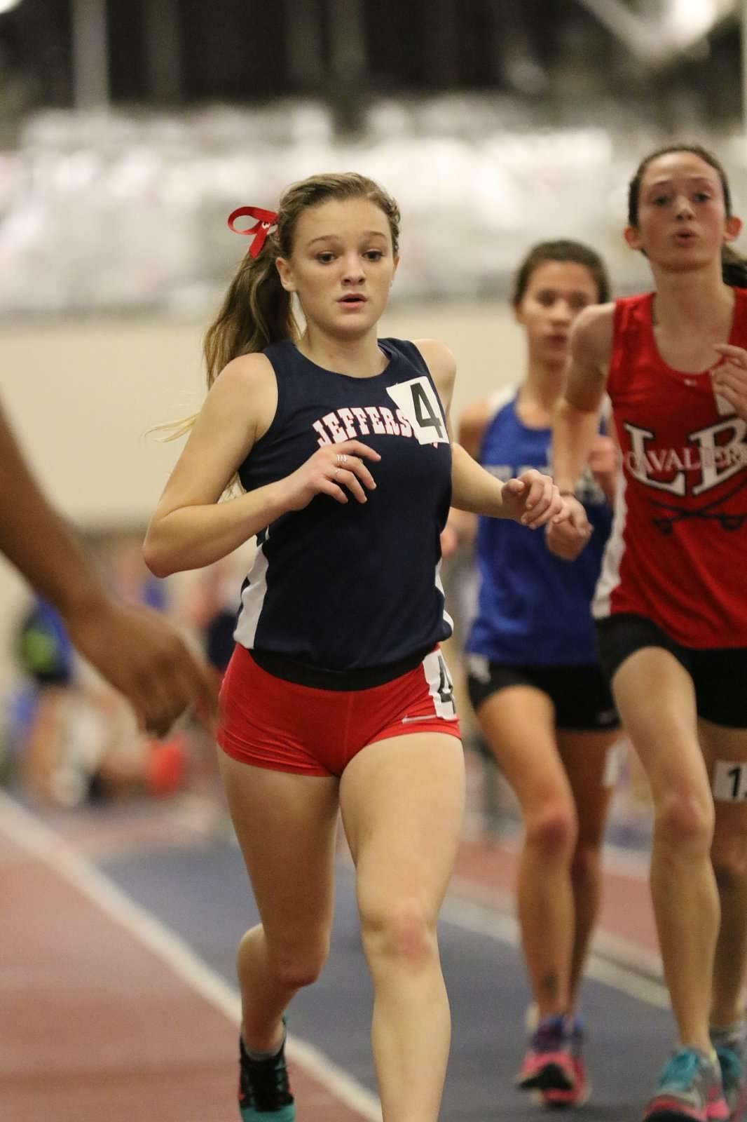 Junior Nora Thompson gives her all at a track meet.  Thompson has been participating in Jefferson track since freshman year.