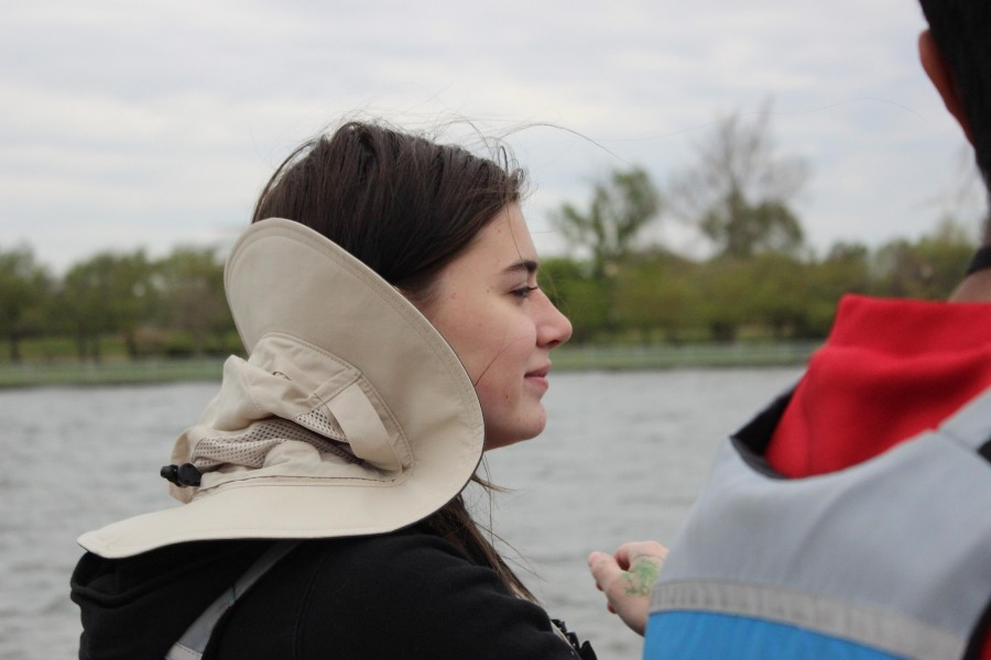 Junior Klara Vertes surveys the landscape from the back of the boat.