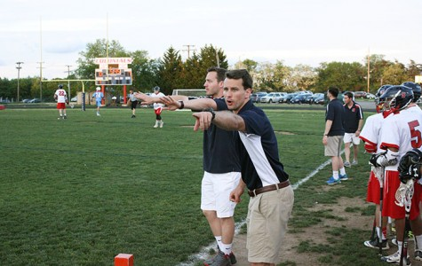 Head Coach Jackson Kibler coaches from the sidelines in a lacrosse game.  He has been the head coach for two seasons.