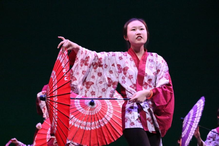 Senior Yeonju Kim gracefully moves across the stage during Japanese National Honor Societys (JNHS) performance.