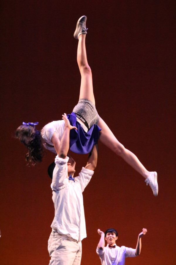 Seniors Cece Xiao and Connor Jones perform an astounding lift during Swings performance.