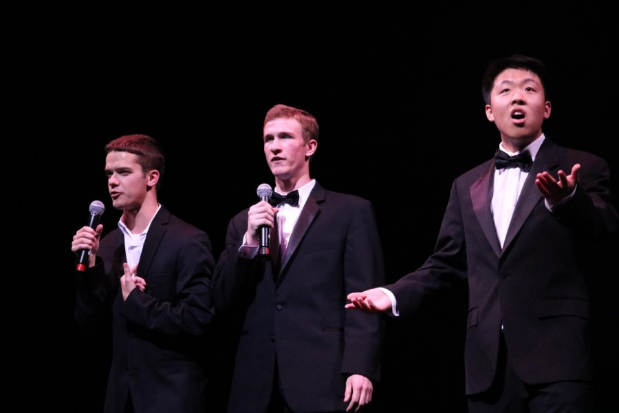 In between performances, the MCs kept the crowd entertained, such as when senior Andy Charbonneau (left) and MCs Jackson Zagurski (middle) and Andrew Huang (right) introduced Asian Awarenesss performance.