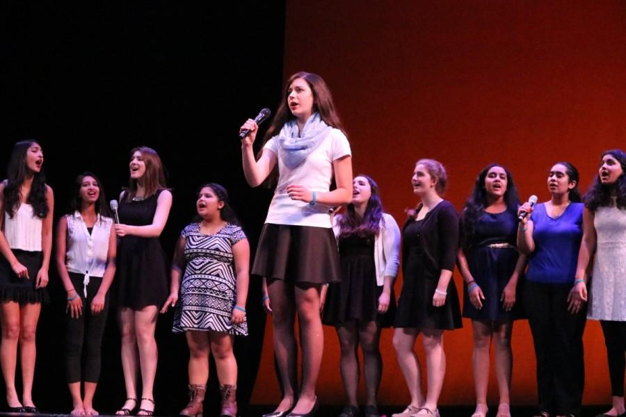 Showchoir wows the crowd with wonderful vocals as senior Olivia Marcantonio helps lead the performance with her solos.